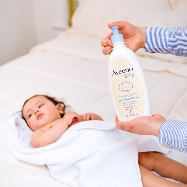 baby with aveeno daily moisturizing lotion