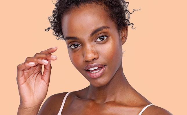 woman with glowing skin using aveeno maxglow