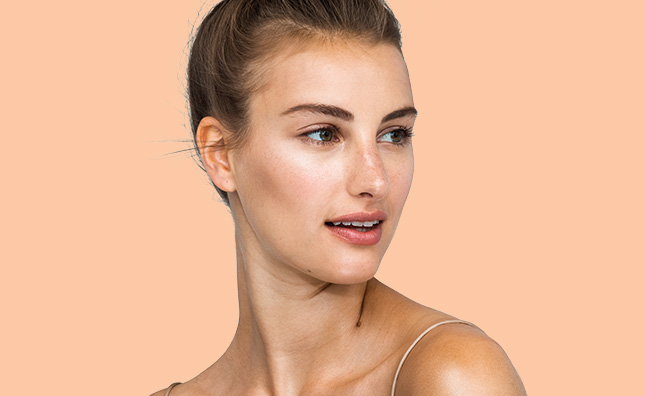 upclose of woman with radiant skin care and neutral makeup