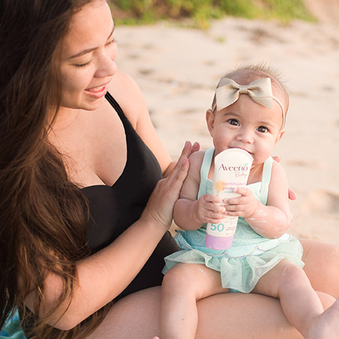 Mother and baby using Aveeno sunscreen